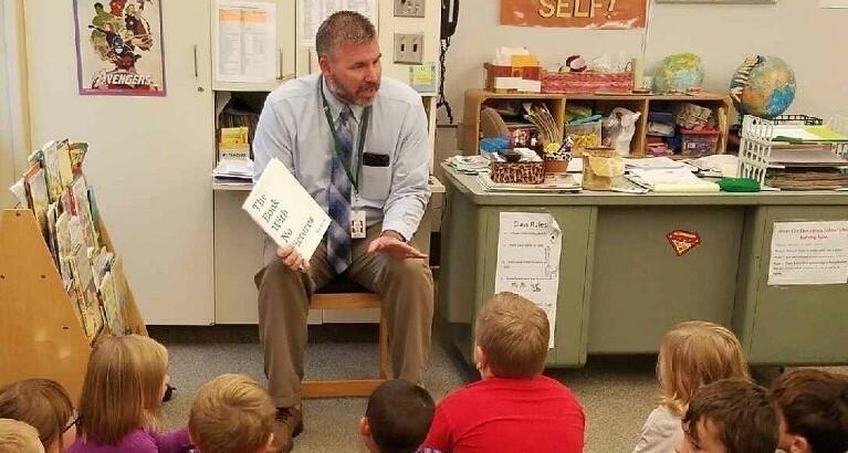 Mr Bennett Reading to Mrs Williams Kindergarten Class